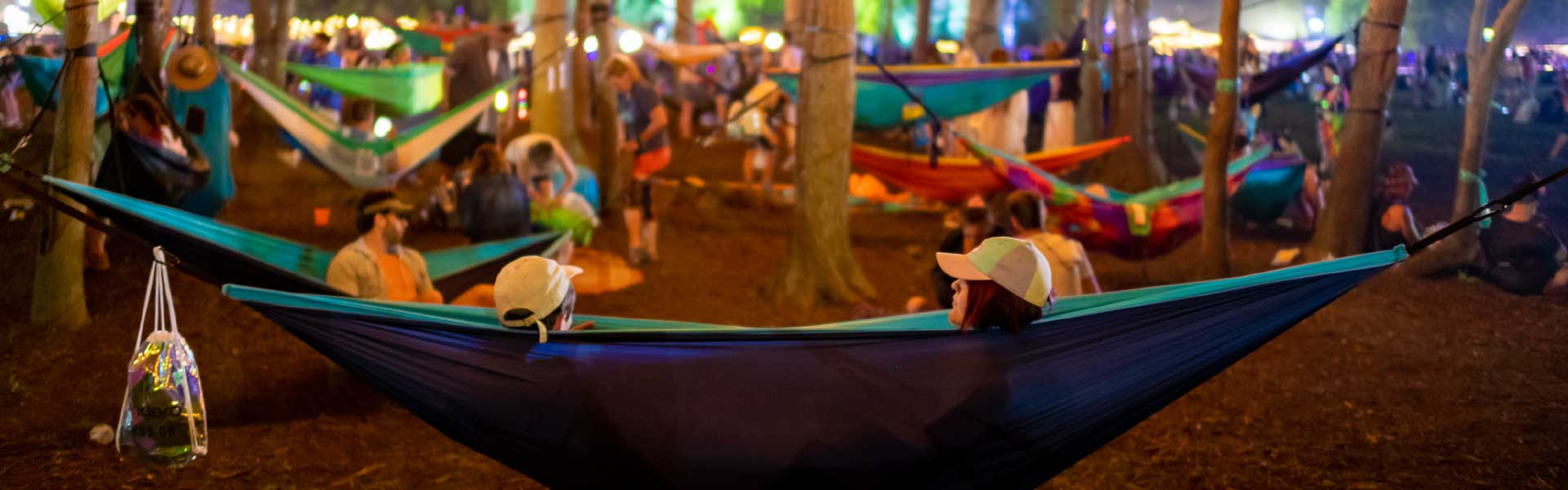 Festival goers in hammock